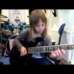 Young Girl Kills Guitar