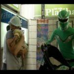 Japanese superhero helps people in the subway station of Tokyo