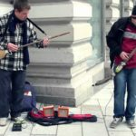 Street musicians with guitars from brooms and shovels