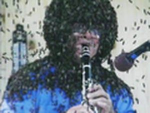 Playing A Clarinet Covered In Bees
