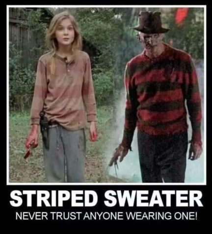 Maid bærer helst af en stribet sweater