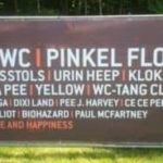 Festival toilets signpost: AC/WC und Pinkel Floyd