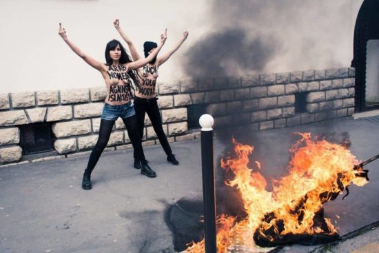 Topless lebanese girls burning ISIS flags…