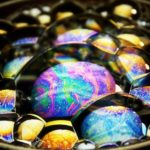 Macro video of pretty iridescent soap bubbles