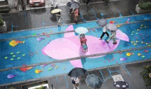 Strassenkunst, die nur bei Regen zum Vorschein kommt