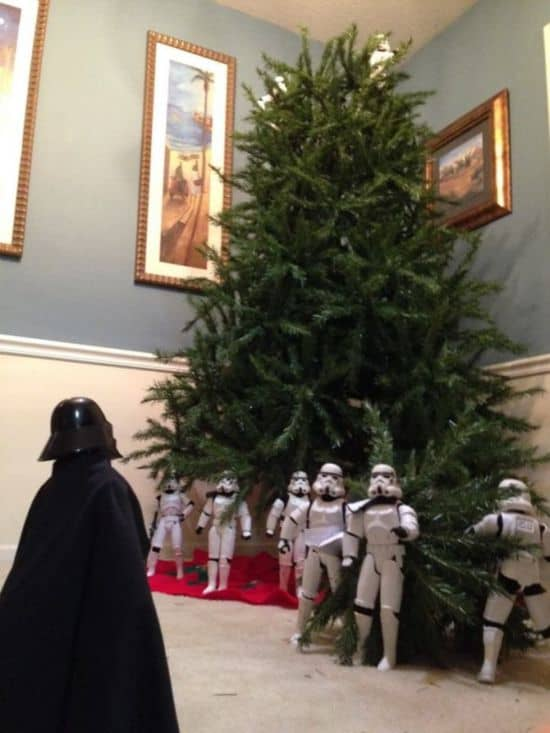 Stormtroopers build the Christmas tree together