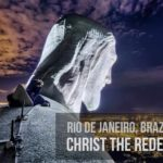 Climb onto the Christ statue in Rio