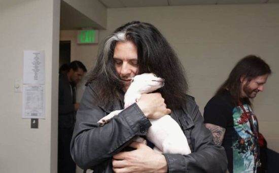 Slayer and Testament cuddle with puppies