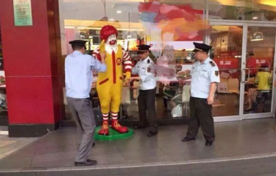 Arrested Ronald McDonald statue of Chinese police