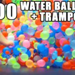 In Slow-Motion mit 1500 Water balloons on a trampoline