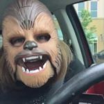 The simple joys in life: Woman highly amused with her Chewbacca mask
