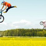 If two jump with the BMX through the rape field