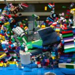 crasht In slow motion a Lego airplane in a Lego city