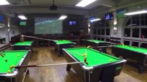 Billiards Trick Shot over dozens of pool tables away