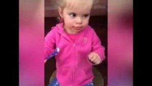 Only a little girl, that for the first time eating ice