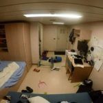 In the cabin of a cargo ship in heavy seas