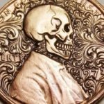 Handmade skull engraving of a Lincoln coin