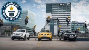 Guinness World Record: jump with a pogo stick about three cars