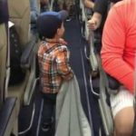 Little boy welcomes all passengers on the plane with Ghetto Faust